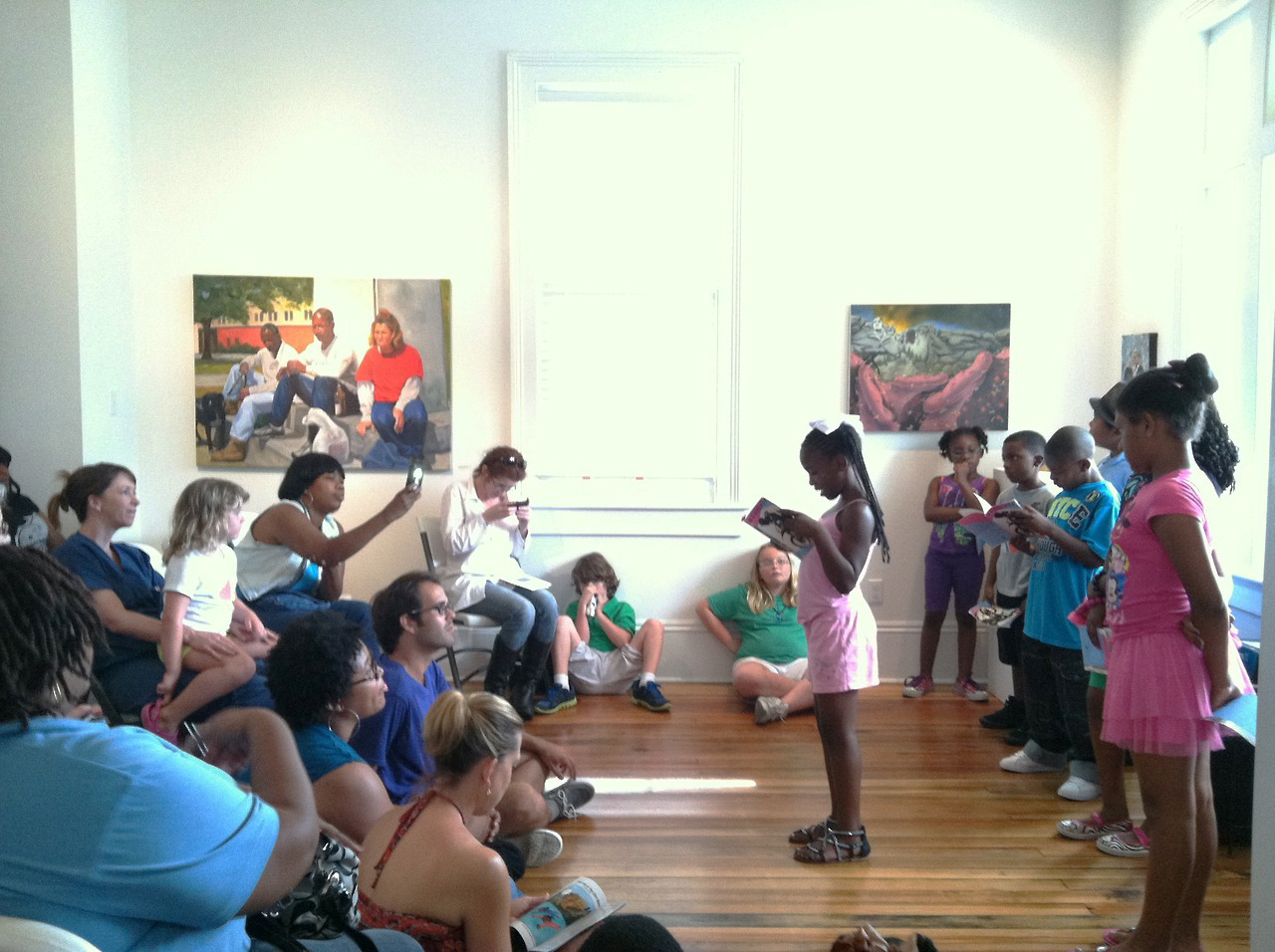 Big Class Student reading in Antenna gallery, 2013 (photo by Doug Keller)