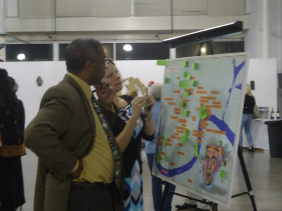 "Randall V Schexnayder and Jessica Daigle add ""places of relief"" to a map during a One Book One New Orleans event about mental health at the Ashe Cultural Arts Center"