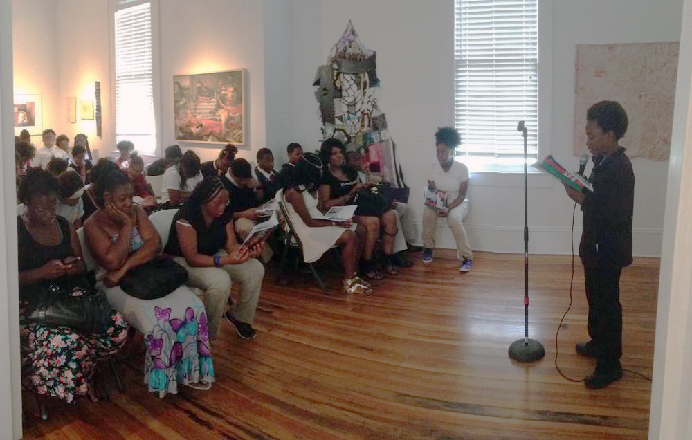 Big Class student reading in Antenna Gallery, 2014.